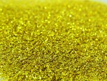 Glitter gold dust and sand background for christmas greeting cards stock images