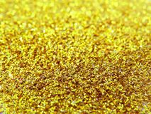 Glitter gold dust and sand background for christmas greeting cards. And New year banners for dreamy holidays and noel eve royalty free stock images