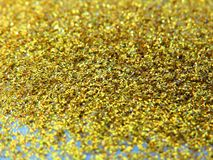 Glitter gold dust and sand background for christmas greeting cards royalty free stock photo