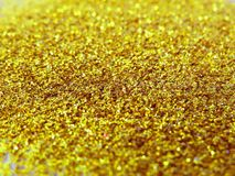 Glitter gold dust and sand background for christmas greeting cards royalty free stock images