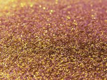 Glitter gold dust and sand background for christmas greeting cards royalty free stock photos