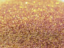 Glitter gold dust and sand background for christmas greeting cards stock photo
