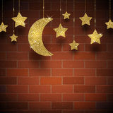 Glitter gold stars and moon. On a brick wall texture background Stock Photos