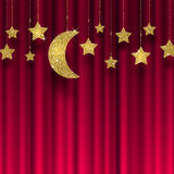 Glitter gold stars and moon. On a red curtain Stock Photo