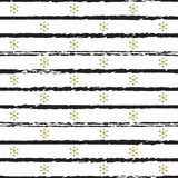 Glitter gold striped Christmas New Year seamless pattern with snowflakes. Paint brush strokes background. Golden Royalty Free Stock Photo