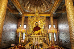Glitter golden buddha. Myanmar art of buddha decorated with  glitter gold pieces in the chamber Royalty Free Stock Photography