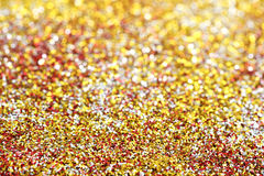 Glitter. Golden, silver and red glitter for backgrounds Stock Images