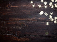 Glitter golden snowflakes on grunge wood Stock Photo