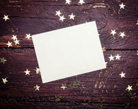 Glitter golden stars  with blank paper Royalty Free Stock Image