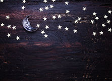 Glitter golden stars and glass moon on grunge wood royalty free stock photos