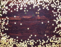 Glitter golden stars on grunge wood royalty free stock images
