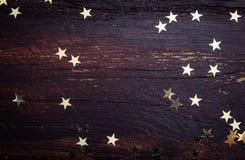 Glitter golden stars on grunge wood Stock Photo