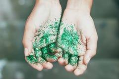 Glitter on hands. Green glitter on hands yong beautiful women Stock Images
