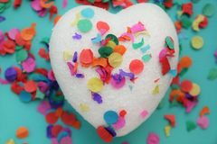 Glitter heart and confetti. A white glitter heart with confetti Royalty Free Stock Images