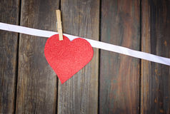 Glitter heart over wood background Stock Photos