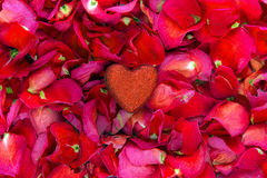 Glitter heart on rose petal background Stock Images