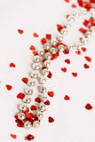 Glitter hearts and pearls. Red glitter hearts on a white background with pearls Royalty Free Stock Images