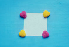 Glitter hearts on turquoise table. Valentine's Day hearts on a wooden background royalty free stock photos