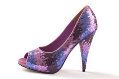 Glitter high heel stilettos shoe. Shiny multicoloured glitter platform high heel shoe, isolated on white Royalty Free Stock Photos