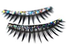 Glitter Lashes. Closeup of false glitter eyelashes stock images