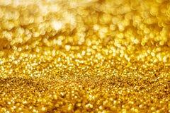 Glitter light abstract gold bokeh blurred background. Glitter light abstract gold bokeh christmas light blurred background stock image