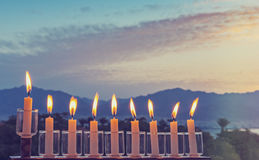 Glitter light of candles against blurred morning cloudscape stock photo