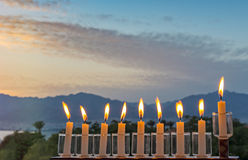 Glitter light of candles against blurred morning cloudscape Royalty Free Stock Image