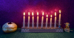 Glitter light of candles, donuts and dreidels royalty free stock photo