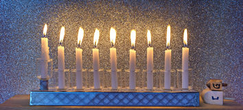 Glitter light of candles and dreidels Royalty Free Stock Photo