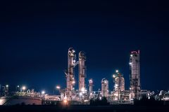 Distillation tower. Glitter lighting of petrochemical plant with distillation tower, Factories at night Stock Image