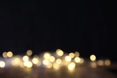 Glitter lights background. dark gold and black. de focused Stock Image