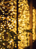 Glitter lights background. Holiday bokeh texture. Dark gold and black. Defocused Royalty Free Stock Image
