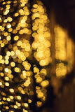 Glitter lights background. Holiday bokeh texture. Dark gold and black. Defocused Stock Photo
