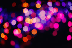 Glitter lights background. Holiday bokeh texture. Multicolored light Stock Photos