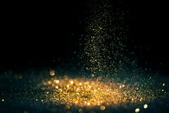 Glitter lights grunge background, gold glitter defocused abstract Twinkly gold Lights Background