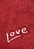 Glitter: Love Written in Red Glitter Background Royalty Free Stock Photos