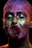 Glitter makeup on a beautiful woman face on a black background Royalty Free Stock Images