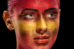 Glitter makeup on a beautiful woman face on a black background Stock Image