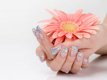 Glitter manicure and pink flower Royalty Free Stock Images