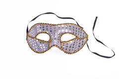 Glitter Masquerade Mask. A glittery silver and gold masquerade mask isolated on white Stock Photography
