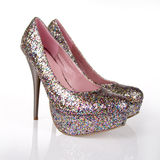 Glitter Multi Colored Shoes. On a white background royalty free stock images