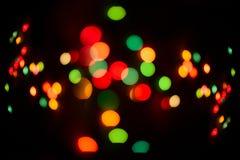Glitter multicolored defocused festive lights Royalty Free Stock Photo