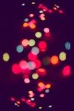 Glitter multicolored defocused festive lights Stock Photo