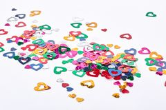 Glitter paper hearts, white background. royalty free stock photography