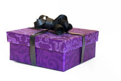 Glitter purple present box with black ribbon Stock Image