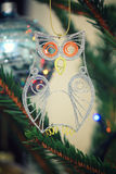 Glitter quilled little owl hanging on a spruce branch Stock Photo