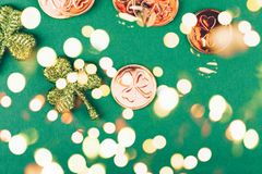 Glitter shamrocks and golden coins on green paper background. St Patricks day symbol. Irish National holiday concept. Bold festive. Glitter shamrocks and golden stock image