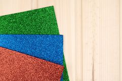Glitter sheets for creativity red blue green. stock photos