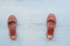 Glitter shoes on gray wooden floor. stock photo