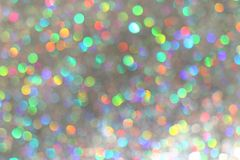 Glitter silver lights background with colorful bokeh. de-focused.  royalty free stock image